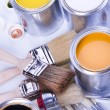 Cans and paint and brushes — Stock Photo