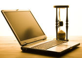 Hourglass & Laptop — Stock Photo