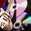 Discs and guitar — Stock Photo