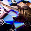 Music on disc & Guitar — Stock Photo