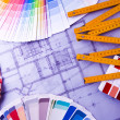 Color samples for selection with house plan on background — Foto de Stock