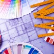 Color samples for selection with house plan on background — Stok fotoğraf