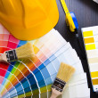 Color samples for selection with house plan on background — Foto Stock