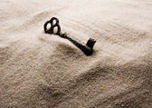 Key in the sand — Stock Photo
