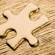 Puzzle on a wooden table — Stock Photo