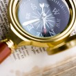 Compass & book & Magnifying glass — Stock Photo