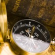 Old style compass and book — Stock Photo