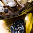 Old style compass and ship — Stock Photo
