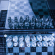 Glass chess with laptop — Stockfoto