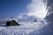Wooden house on winter landscape — Stock Photo
