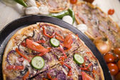 Supreme pizza in pan — Stock Photo