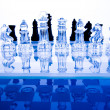 Chess on glass table — Foto de Stock