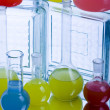 Laboratory flasks with fluids of different colors — Stock Photo #30787763
