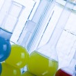 Laboratory flasks with fluids of different colors — Stock Photo #30788567
