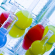 Laboratory flasks with fluids of different colors — Stock Photo #30789051