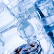 Laboratory glassware with drugs — Stock Photo