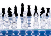Chess on glass table — Stock Photo