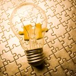 Light bulb on jigsaws — Stock Photo
