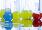 Laboratory flasks with fluids of different colors — Stock Photo