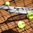 Tennis racket with tennis ball — Stockfoto