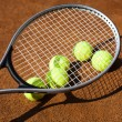 Stock Photo: Tennis racket with tennis ball