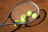 Tennis racket with tennis ball — Stock Photo