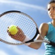 Stock Photo: Young womplaying tennis