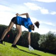 Girl playing golf on grass in summer — ストック写真