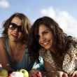 Girlfriends on picnic — Stock Photo #32563957