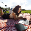 Girl on a picnic with laptop — Stock Photo #32564433