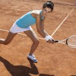 Woman playing tennis in summer — Foto Stock