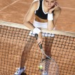 Woman playing tennis — Stock Photo