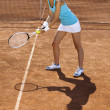 Woman playing tennis in summer — Stock Photo