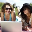 Girlfriends with laptop — Stock Photo