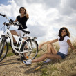 Young girls riding a bicycle — Stock Photo