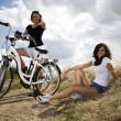 Stock Photo: Young girls riding a bicycle