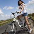 Girl riding her bike — Stock Photo