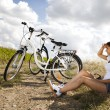 Girl with a bicycle enjoying — Stock Photo #32567771