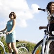 Girl with a bicycle enjoying — Stock Photo #32567861