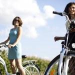 Girl with a bicycle enjoying — Stock Photo