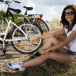 Girl with a bicycle enjoying — Stock Photo #32568077