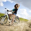 Girl with a bicycle enjoying — Stock Photo