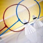 Shuttlecock on badminton racket — Stock Photo #34179015