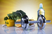 Diet and fitness, dumbell with vitamin, sunset — Stock Photo