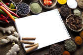 Cookbook and spices — Stock Photo