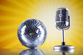 Microphone with disco ball — Stock Photo
