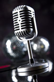 Microphone with disco balls — Stock fotografie