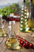 Olive oil with cherry tomatoes — Stock Photo