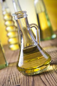 Glass carafe with olive oil — Stock Photo