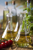 Olive oil with tomatoes — Stock Photo